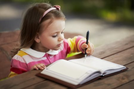 Optimized-cute-little-girl-learning-to-write-PDQRKMH-min