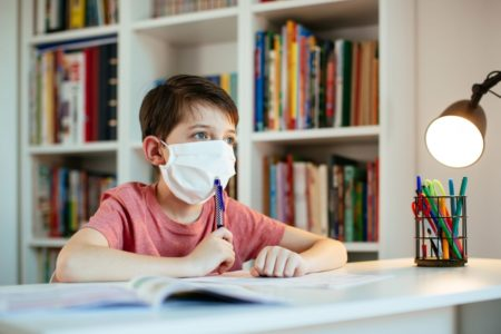 Optimized-child-wearing-face-mask-self-studying-at-home-duri-ES34JM3